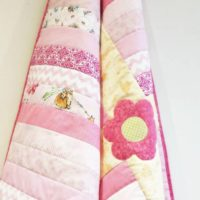 Pretty Pink Quilt with Flower Applique