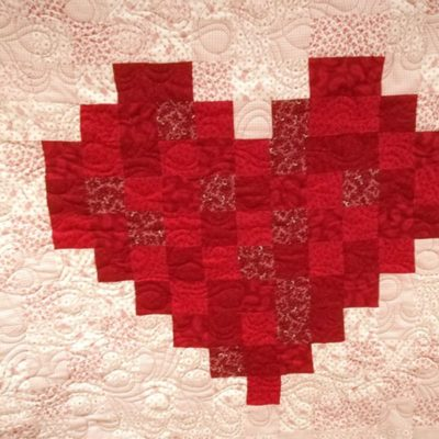 Beautiful Pixelated Heart Baby Quilt